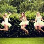 Beautiful happy young women jumping. — Stock Photo #27106641