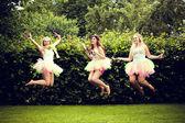 Beautiful happy young women jumping. — Stock Photo