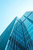 Office buildings. modern glass wall of skyscraper — Stock Photo