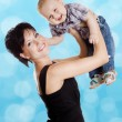 Beautiful happy mother with attractive baby — Stockfoto #27618183