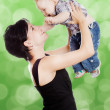 Beautiful happy mother with attractive baby — Stockfoto