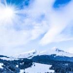 Winter mountains. sun shine in blue sky — Stock Photo #27629019