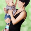 Beautiful happy mother with attractive baby boy — Stockfoto