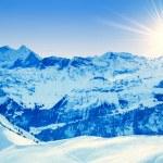 Winter mountains. sun shine in blue sky — Stock Photo #28301701