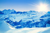 Winter mountains. sun shine in blue sky — Stock Photo