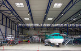 The passenger aircraft in the hangar — Stock Photo