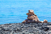 Stack of stones on a seashore. — Stock Photo