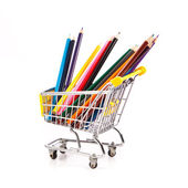 Color pencils in shopping cart — Stock Photo