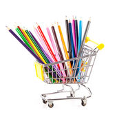 Color pencils in shopping cart. — Stock Photo