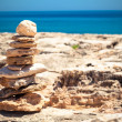 Stones balance, pebbles stack over blue sea — Stock Photo