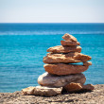 Stones balance, pebbles stack over blue sea — Stock Photo #29905757