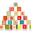 Wooden toy cubes with letters. Wooden alphabet blocks. — Stock fotografie