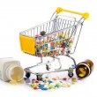 Colorful tablets in the cart.  Shopping cart with medicine pills — Foto Stock