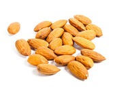 Heap of almond nuts isolated on white background — Stock Photo