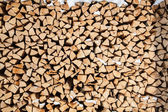 Pile of firewood. snowy firewoods in winter forest — Stock Photo