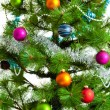 Christmas decorations. Christmas ball and green spruce branch — Stock Photo #31971327