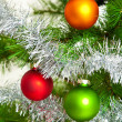 Christmas decorations. Christmas ball and green spruce branch — Stock Photo #31972109