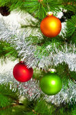 Christmas decorations. Christmas ball and green spruce branch — Stock Photo