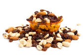 Nuts and raisins isolated on white — Stock Photo