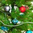 Christmas decorations. Christmas ball and green spruce branch — Stock Photo #32482347