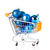 Shopping cart full of christmas balls — Стоковое фото