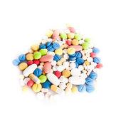 Barevné pilulky izolovaných na bílém — Stock fotografie