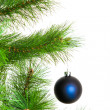 Christmas ball and fir tree — Stock Photo #34186745