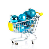 Shopping cart full of christmas balls isolated — Foto Stock