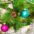 Christmas decorations hanging on christmas tree — Stock Photo #34227481