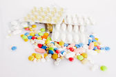 Colorful pills isolated on white — Stock fotografie