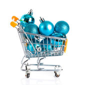 Shopping cart full of christmas balls isolated on white backgrou — Stock Photo