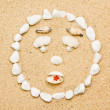 Smile of shells on the sand. funny smile — Stock Photo
