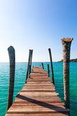 Tropical Resort. boardwalk on beach — Stock Photo