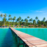 Tropical Resort. boardwalk on beach — Stock Photo #37985623