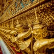Temple of the Emerald Buddha. Gold ornamental patter statuettes — Stock Photo