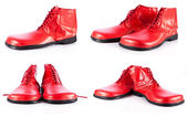 Red clown shoes on a white background  — 图库照片