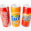 Coca-Cola, Fanta and Mezzo Mix cans on white background. — Stock Photo