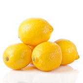 Ripe lemons on a white background — Stock Photo