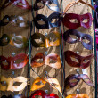Various venetian masks on sale .  colorful artistic masks on the — Stock Photo #47814773