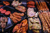 Marinaded meat for grilling in a counter display in a supermarke — Stock Photo
