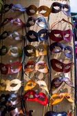 Various venetian masks on sale .  colorful artistic masks on the — Stock Photo