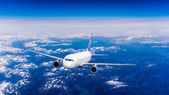 Airplane flying in sky — Stock Photo