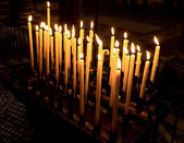 Church candle in a row — Stock Photo