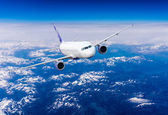 Airplane in sky — Stock Photo