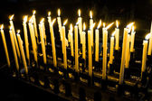 Church candles in a row — Stock Photo