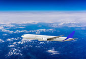 Airplane over the clouds  — Stockfoto