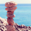 Balanced stones, pebbles stacks against blue sea with a instagr — Stock Photo #49453629