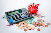 Red piggy bank with calculator — Stock Photo