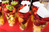 Fresh fruit salad on market — Stock Photo