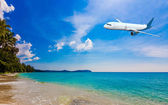 Jet plane over tropical sea — Stock Photo